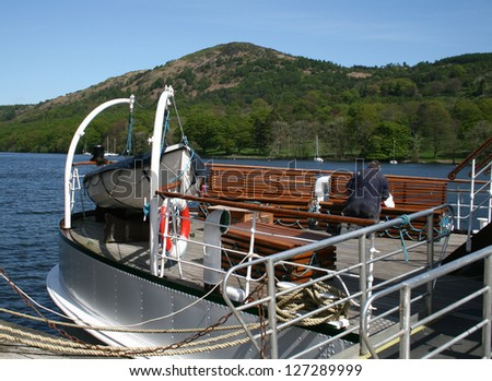 repairs being made on a tourist lake cruiser - stock photo
