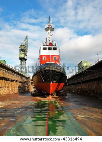 Reparation Fire-boat in large floating dry dock. - stock photo