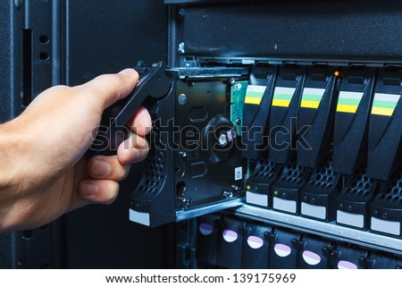 replacement of a defective hard drive (hdd) in the storage system in the data center - stock photo