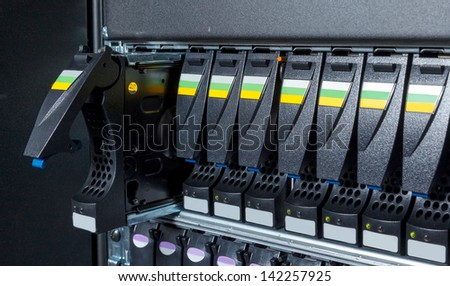 replacement of a defective hard drive in the storage system in the data center - stock photo