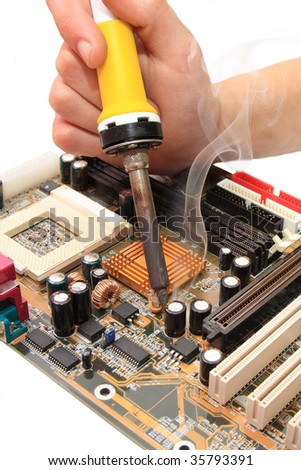 replacement of broken capacitors on the motherboard by CU
