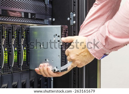 replacement of faulty blade server in chassis, the platform virtualization in the data center server rack - stock photo
