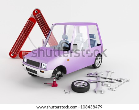 Replacement of flat tire from a toy car - stock photo