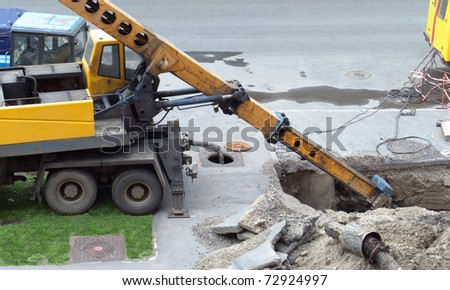 Replacement of old water pipes. Excavator dug a trench - stock photo