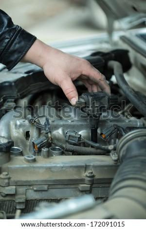 Replacement tip spark plugs, car repair - stock photo
