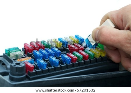 Replacing or inspecting a car fuse using a pull tool. Selective focus and copy-space. - stock photo