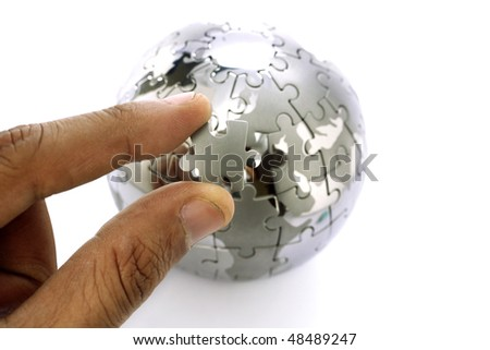 Replacing the missed Jigsaw puzzle piece - stock photo