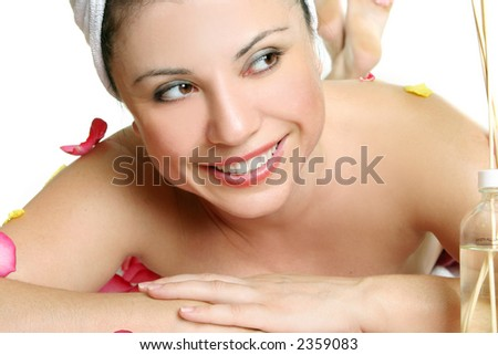 Replenish your body and soul at a day spa.  A woman treats herself to some pampered luxuries at a day spa.  Ahh bliss. - stock photo