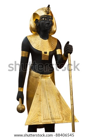 Reply of a Guardian Statue of Tutankhamen's tomb, isolated with clipping path. Guarding Tutankhamun's Burial Chamber, this gilded wooden statues represented his ka, or soul. - stock photo