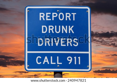 Report drunk drivers highway sign with sunset sky. - stock photo