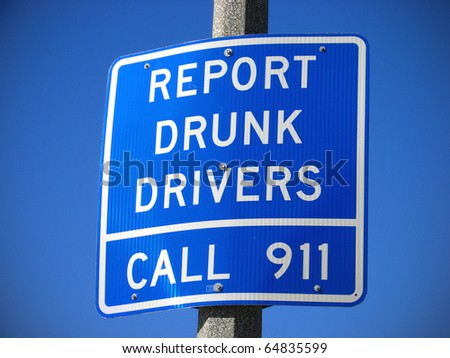 report drunk drivers sign with blue sky