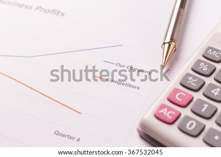 Report of success business profits and pen and calculator.