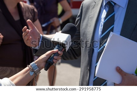 Reporter making interview