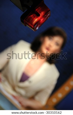 Reporter presenting news in TV studio - On the air sign - stock photo