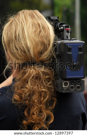 Reporter viewed from back. - stock photo