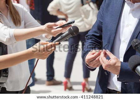 Reporters making interview with businessman or politician - stock photo