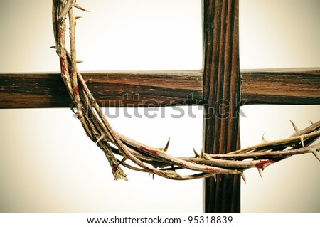 representation of the crown of thorns and the cross of Jesus Christ - stock photo