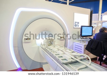Representative sits on the exhibition of medical equipment - stock photo