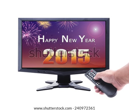 Represents the new year. Human hand holding remote and monitor display 2015 isolated on white. - stock photo