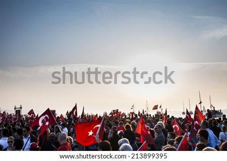 Republic day of Turkey.People have  Turkish flasg on their hands.Gundogdu Square October 29 2013.Izmir Turkey - stock photo