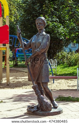 Republic of Belarus, city of Minsk 8/26/2016. A sculpture the young woman holding the broom of a floor.