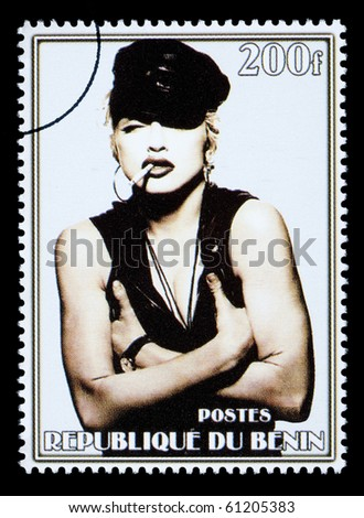 REPUBLIC OF BENIN - CIRCA 2002: A postage stamp printed in the Republic of Benin showing Madonna Louise Ciccone, circa 2002 - stock photo