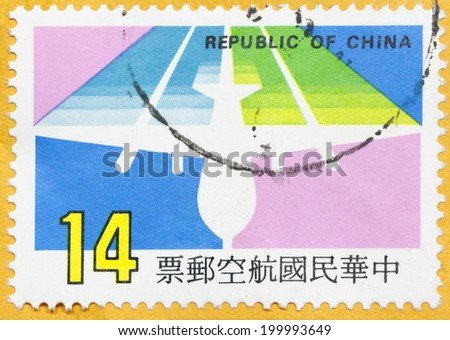 REPUBLIC OF CHINA (TAIWAN) - CIRCA 1987:A stamp printed in Taiwan shows shows a stylized airplane, circa 1987 - stock photo