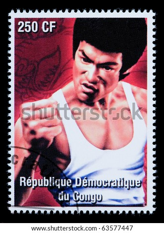 REPUBLIC OF CONGO - CIRCA 2000: A postage stamp printed in the Congo Republic showing Bruce Lee, circa 2000 - stock photo