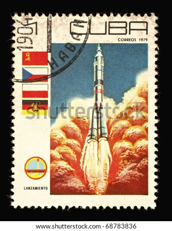 REPUBLIC OF CUBA - CIRCA 1979: A vintage postal stamp printed in Cuba with a postmark dated 1904, depicting a rocket launch named Lanzamiento into space circa 1979 - stock photo