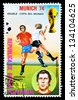 REPUBLIC OF EQUATORIAL GUINEA - CIRCA 1974: A stamp printed in the Republic of Equatorial Guinea shows football player (World Cup : Munich, Germany) and portrait Amancio (Spain), circa 1974. - stock photo