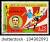 REPUBLIC OF EQUATORIAL GUINEA - CIRCA 1974: A stamp printed in the Republic of Equatorial Guinea shows football player (World Cup : Munich, Germany) and portrait Riva (Italy), circa 1974. - stock photo