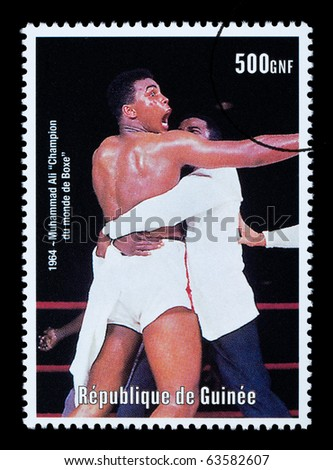 REPUBLIC OF GUINEA - CIRCA 2000: A postage stamp printed in Guinea showing  Muhammad Ali, circa 2000 - stock photo