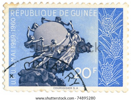 REPUBLIC OF GUINEA - CIRCA 1960: A postage stamp thesis is the anniversary of Guinea's UPU (Universal Postal Union) accession, series, circa 1960