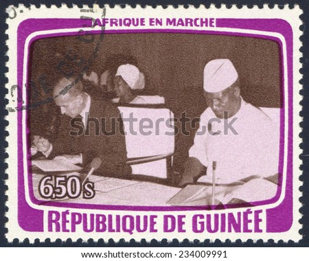 REPUBLIC OF GUINEA - CIRCA 1979: A stamp printed in Republic of Guinea shows French President Valery Giscard dâEstaing and Sekou Toure, circa 1979