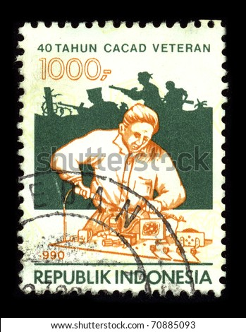 REPUBLIC OF INDONESIA - CIRCA 1990: A stamp dedicated to the 40-year veteran disability, circa 1990. - stock photo