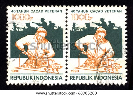 REPUBLIC OF INDONESIA - CIRCA 1990: Two stamp dedicated to the 40-year veteran disability, circa 1990. - stock photo