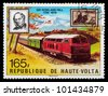 REPUBLIC OF UPPER VOLTA, BURKINA FASO - CIRCA 1979: A stamp printed in Republic of Upper Volta shows portrait of sir Rowland Hill and train, circa 1979 - stock photo