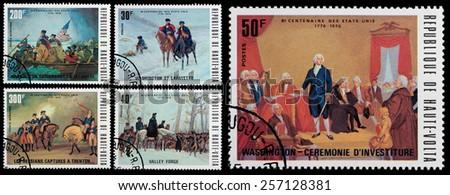 REPUBLIC OF UPPER VOLTA - CIRCA 1976: A stamp printed in Republic of Upper Volta shows President Washington and the American Revolution, circa 1976 - stock photo
