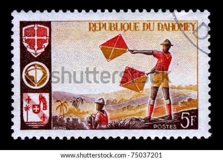 REPUBLIQUE DU DAHOMEY - CIRCA 1990:A stamp printed in REPUBLIQUE DU DAHOMEY shows image of the Scouts in Africa, circa 1990. - stock photo