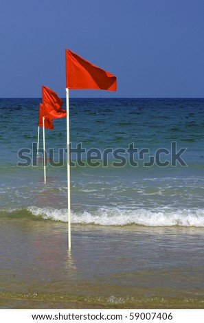 res warning flags in shallow water - stock photo