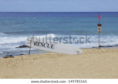 Rescue and Swimming Warning Signs Hawaii Beach - stock photo