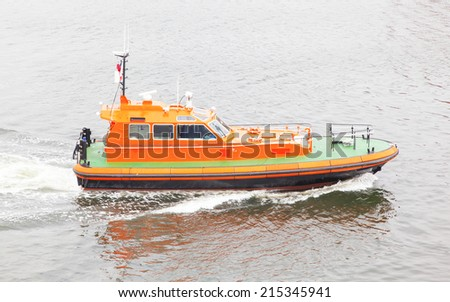 Rescue boat in the water, no people - stock photo