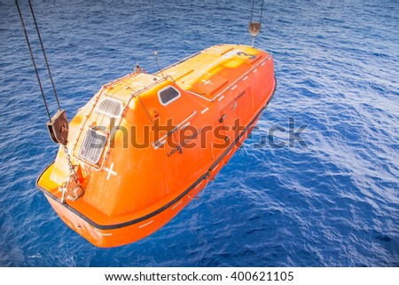 rescue boat or life boat at oil and gas platform annual sea trial test for preventive maintenance,this use for escape or evacuate from fire when abandon platform - stock photo