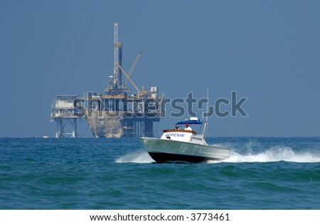 Rescue Boat Patrols Coast in Southern California - stock photo