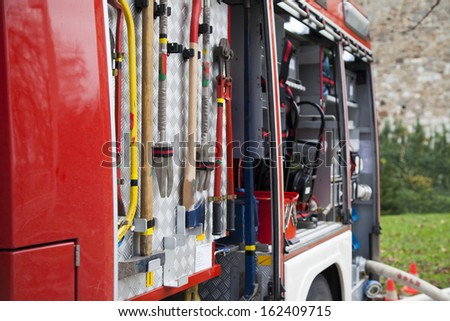 Rescue equipment and tool of fire-fighting truck, close-up - stock photo