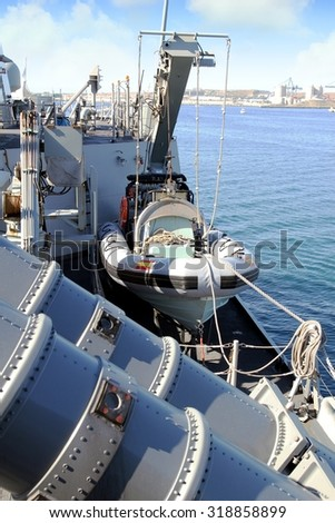 Rescue go-fast zodiac on a warship - stock photo