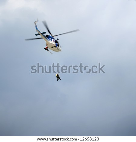 rescue helicopter in the air - stock photo