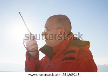 rescue man with radio - stock photo