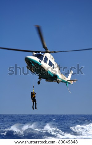 Rescue of the person on the sea by means of the helicopter.Rescue operation at sea. - stock photo