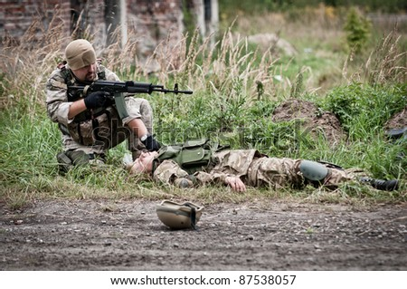 rescue of wounded soldier - stock photo